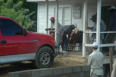 Bro. Paul packs down fill dirt with his truck